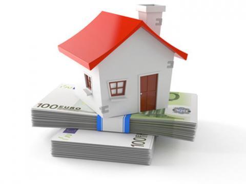 Huis op stapel euro's